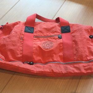 Hot pink Kipling overnight bag